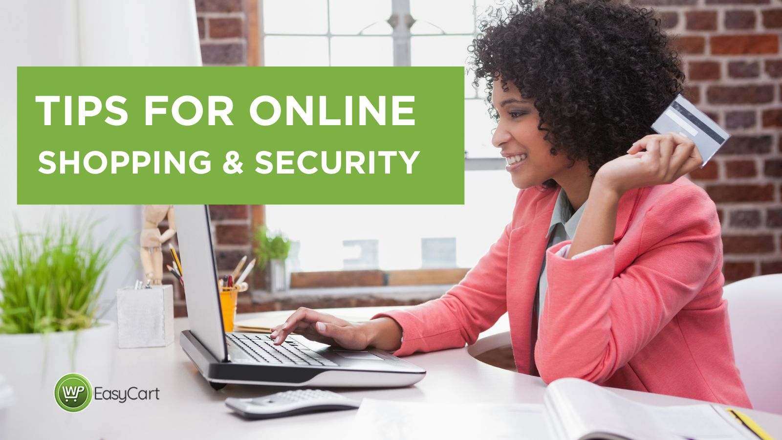 Tips for online shopping and security; woman with credit card in front of laptop.